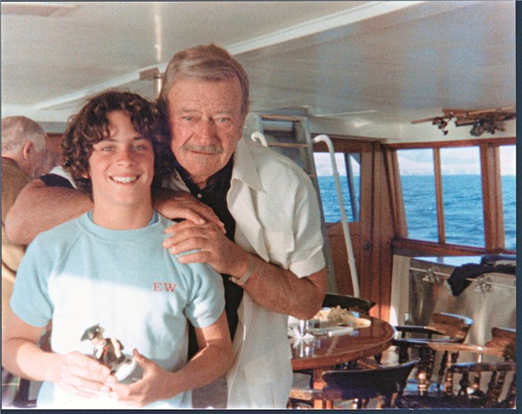 John Wayne and youngest son Ethan Wayne enjoy an afternoon together aboard the…