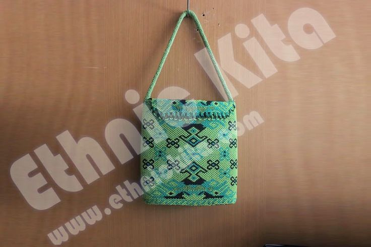 "Beaded Handbags with ""Borneo Motif"".    Measurements : Hight: 28cm x Width: 29cm   Material : Beadeds from kalimantan   Basic Color : Green   Motif : Black borneo motif   Ethnic Of : Kalimantan, Indonesia"