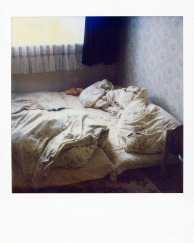 Polaroid from a collection of real photos from the secret archive of the Stasi (former East German secret police), discovered and exhibited by Simon Menner. Polaroids like this were taken by Stasi agents before they conducted secret searches of homes and apartments so they could document exactly what a room looked like before they ransacked it. They then could painstakingly put everything back in place, and hide any trace of having been there.