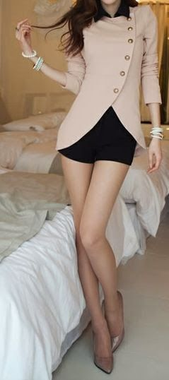 Stylish jacket with black shorts and classic neutrals
