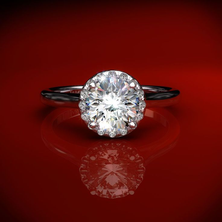 Halo Engagement Setting in White Gold - Ring price excludes center diamond.