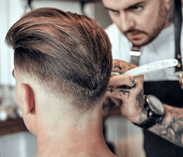 Taper Fade and Slicked Back Hairstyle For Men