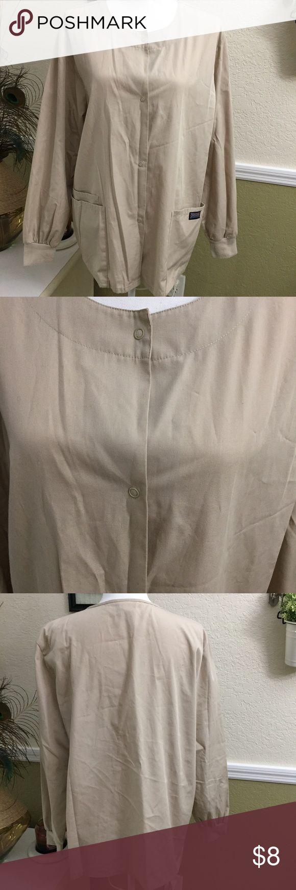 Cherokee Scrub Jacket Nice beige color jacket, has three side pockets, snaps down the front, in great condition. Cherokee Jackets & Coats Utility Jackets