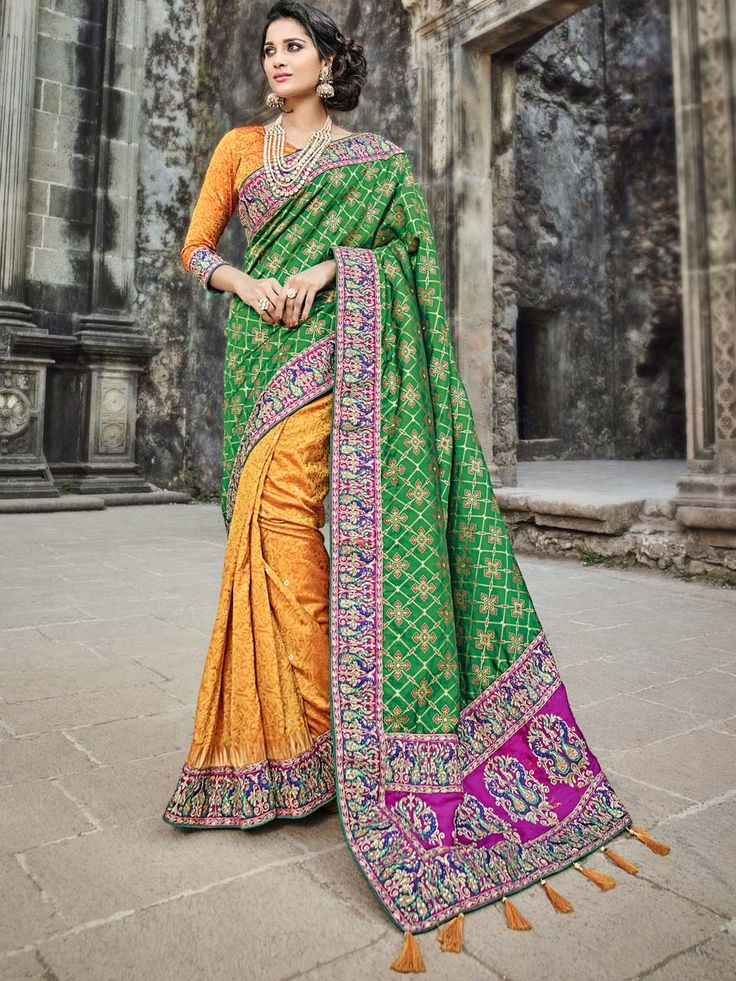 Fabulous saree is designed with green banarasi silk pallu orange jacquard skirt part with  patch border and tussles are giving fashionable flash to it. Look absolutely stunning for party with this outfit.