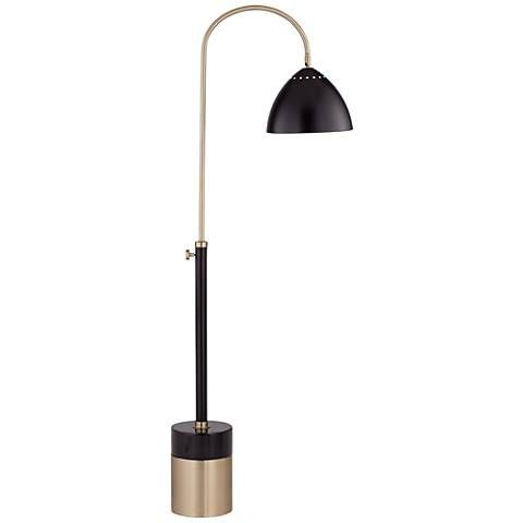 A natural black marble accent on the base of this transitional floor lamp matches the finish on its retro-style metal dome shade.