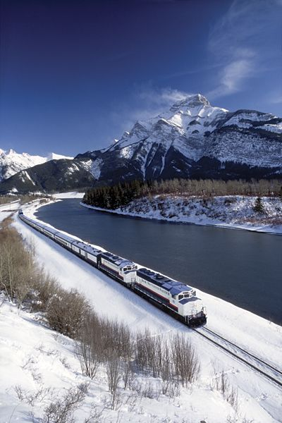 """The """"Rocky Mountaineer Train"""" on the Canadian Pacific Railway through Banff National Park."""