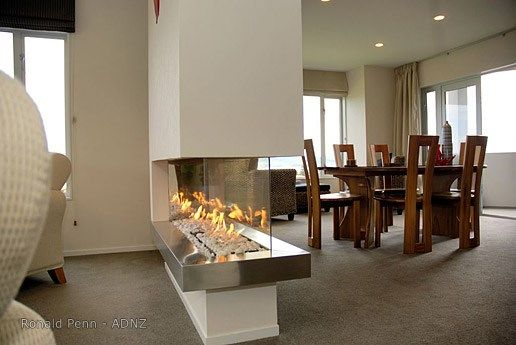 Stunning fireplace, house designed by Ronald Penn.  #adnz #fireplace
