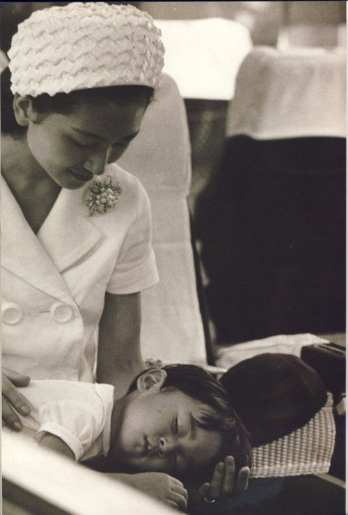 Empress Michiko of Japan with her sleeping son in the 1960s.