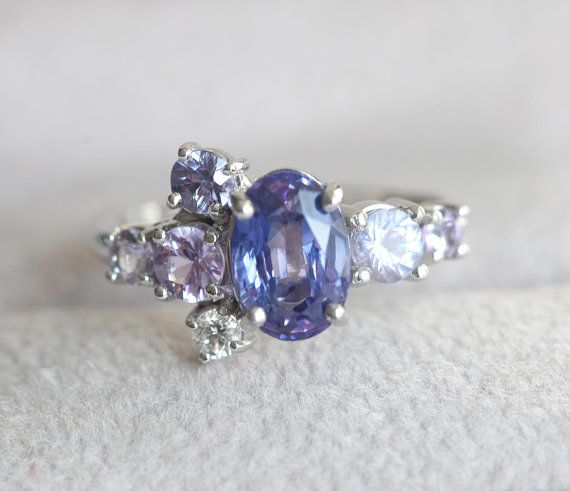 So sparkly and so special! ONE OF A KIND sapphire cluster ring. Ring features a cluster of sparkling blue purple shade sapphires, which create very unique and sparkly look.  This ring would be a perfect ring for non traditional bride. Similar design can be also made with other type/color gemstones per request. Please contact me for custom ring through our etsy shop. Please choose ring size and metal at the drop down menu. Larger sizes thank 8 available upon request.  Product info: ▲ soli...