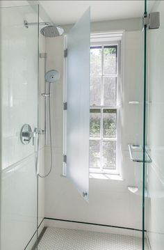 what a cool idea! Have your window in the shower and protect it with a glass shutter