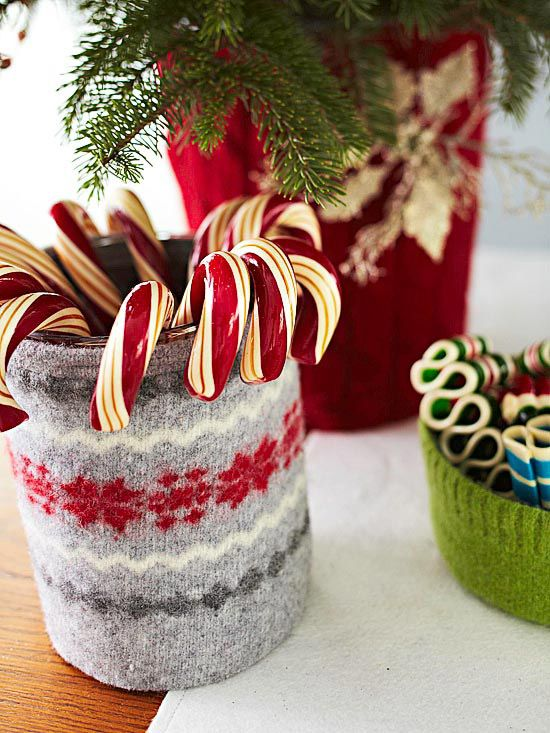 Wrap containers with old sweater sleeves for a festive look! More holiday crafts: http://www.bhg.com/christmas/crafts/christmas-holiday-crafts/#page=20