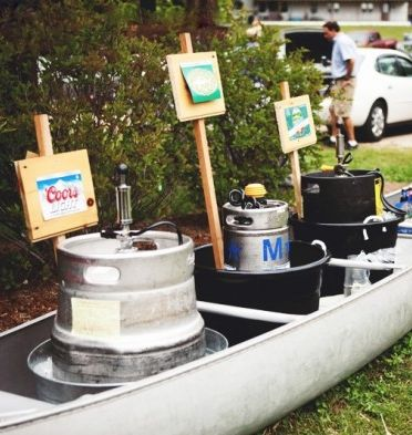 Canoe as wedding drink station.