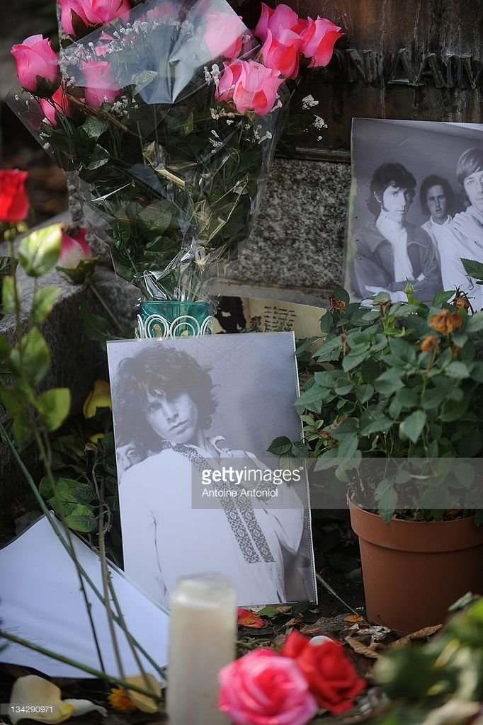 Pictures and flowers are seen on American singer Jim Morrison grave at Cimetierre du Pere Lachaise on November 29, 2011 in Paris, France.