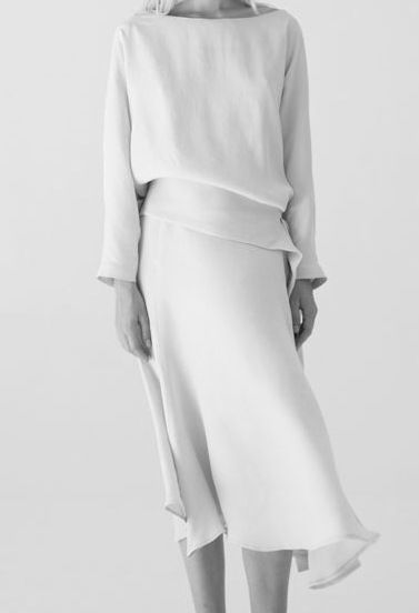 Chic Minimalist Stylish OUTFIT: | Elegant Understated ASYMMETRICAL White BLOUSE + White SKIRT (Mini or MAXI) + ADD White Round-Toed FLATS + Silver and Pearl Jewelry.