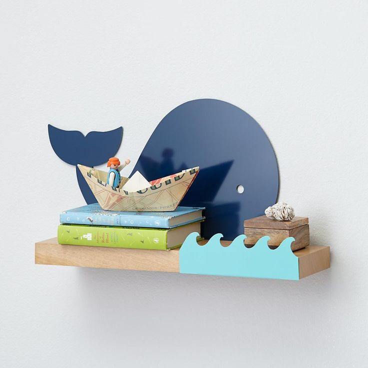 Much like a whale, this shelf floats. Unlike a whale, this shelf floats on your wall. Uniquely designed whale wall shelf can hold up to 30 lbs. of books, toys, and trinkets.