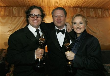 Former U.S. Vice President Al Gore took center stage at the Oscars as the big-screen adaptation of his slide-show lecture about the perils of global warming won Academy Awards for best documentary and best song. (pictured with Director David Guggenheim and Melissa Etheridge)