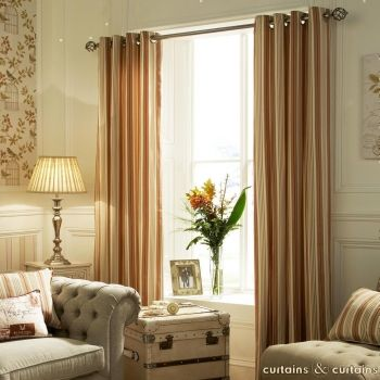 Neutral creams and bright oranges combine in these striped #curtains