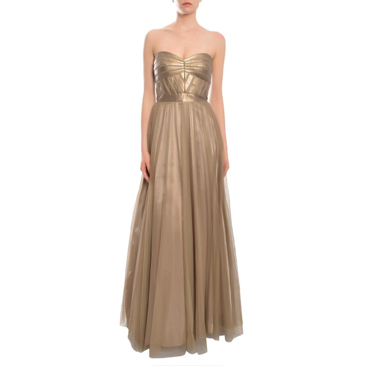 A paneled, leather-like metallic bodice lends a trend-right look to Aidan Mattox's of-the-moment mesh skirt gown. This mink gold dress is floor-length and includes a strapless sweetheart neckline.