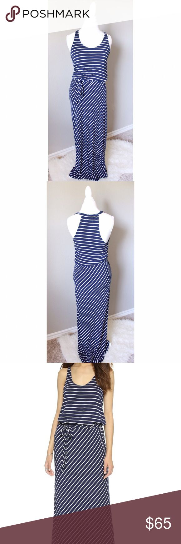 Soft Joie Navy and White Stripe Maribel Maxi Dress Soft Joie Navy and White Stripe Maribel Maxi Dress  Breton stripes accent this racer-back Soft Joie dress. Covered elastic waist and self-belt. Unlined.  Fabric: Jersey. 94% viscose/6% elastane.  Measurements Length: 59in / 150cm, from shoulder  Very small hole next to tag (see photo). Gently used Joie Dresses Maxi