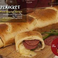 """Ro-cket """"Roll"""" Pizza dengan isi daging Pepperoni, Beef Mince Bologna Sauce, Italian Herbs, Onion, Green Paprika, NZ Mozzarella, Yellow Cheese Cream, Mozzarella, dan campuran bahan-bahan segar berkualitas.  Berat: 320 Gram (with box) Panjang: 30 cm (Ideal maksimum dipotong menjadi 8 slices) Kondisi: Frozen atau Siap Saji Daya Tahan: Frozen bisa disimpan selama 3 bulan Re-heat: keluarkan dari freezer, biarkan suhu ruang atau defrost lalu reheat menggunakan microwave, oven atau teflon."""