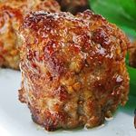 ATKINS LOW CARB BAKED MEATBALLS: 1 tablespoon olive oil, ½ green onion finely chopped, 3 garlic cloves minced, 3/4 pound ground beef, 3/4 pound ground pork, ½ cup grated Parmesan cheese, 2 eggs, ½ teaspoon salt, ¼ teaspoon pepper. Net carbs = 2 g