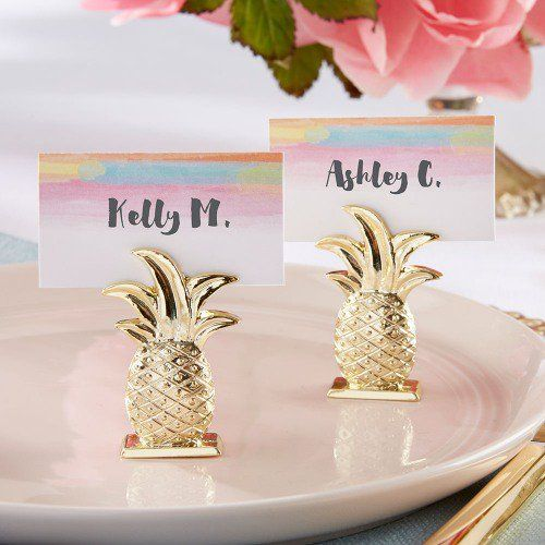 Immerse your wedding guests in a tropical paradise, with these gold pineapple place card holders.
