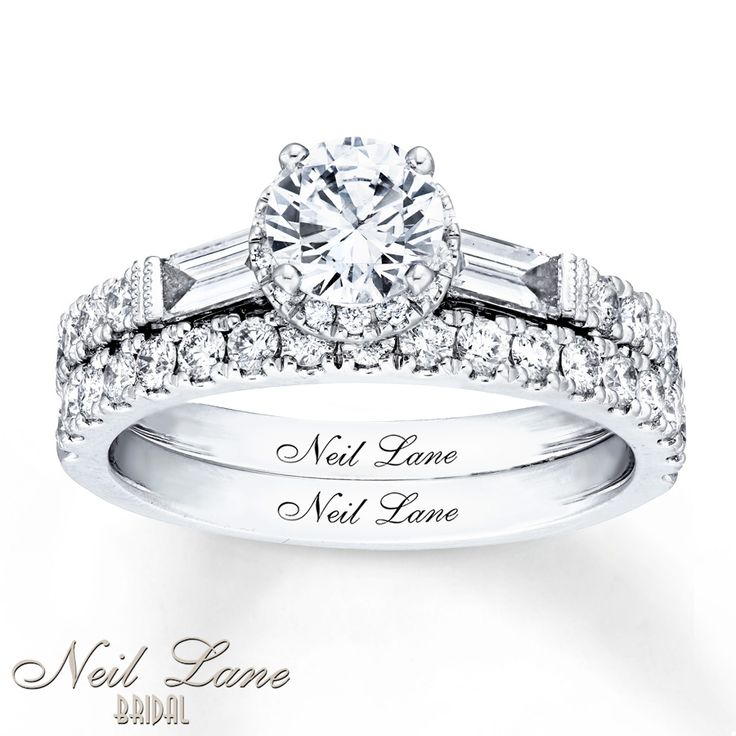 A stunning round diamond is framed by two magnificent baguette diamonds in this bridal set that's fit for the red carpet from Neil Lane Bridal®. Glistening round diamonds line the 14K white gold band of the engagement ring and the matching wedding ring for a total diamond weight for the bridal set of 1 5/8 carats. Neil Lane's signature appears inside each band. Diamond Total Carat Weight may range from 1.58 - 1.68 carats. Diamond Total Carat Weight may range from 1.58 - ...