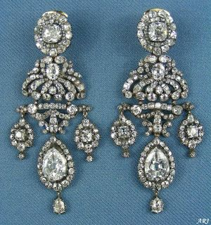 Princess Marina's Girandole Earrings. This gorgeous pair is made in a classical girandole design, which was developed in France in 1700s and named after the crystal-pendant candelabras of the time. It went out of fashion in early 19th century but then underwent a period of a renaissance during the revival of Rococo styles in late 19th century.