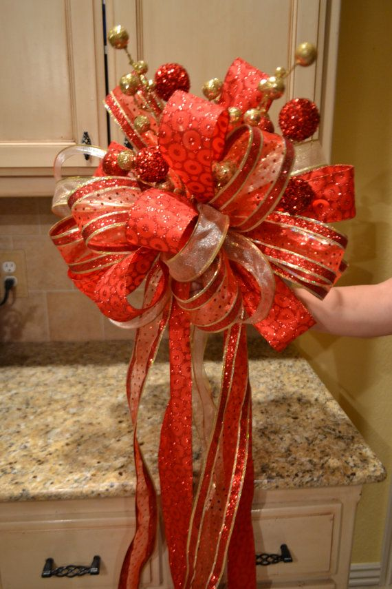 red and gold ribbon tree topper trees tree toppers and red. Black Bedroom Furniture Sets. Home Design Ideas