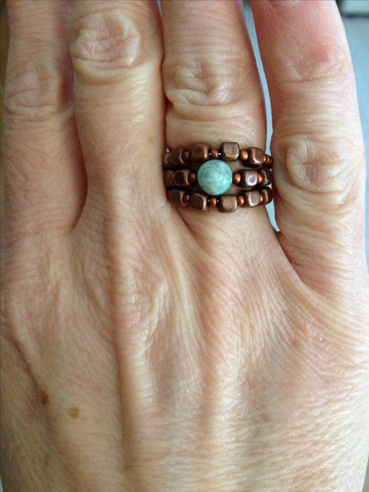 Copper and African Jade bead ring on memory wire.