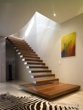 do like the platform base and the cantilevered step treads and the cable look balustrade