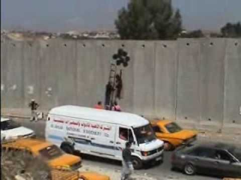 Banksy in the West Bank of Israel (with his team caught on camera)
