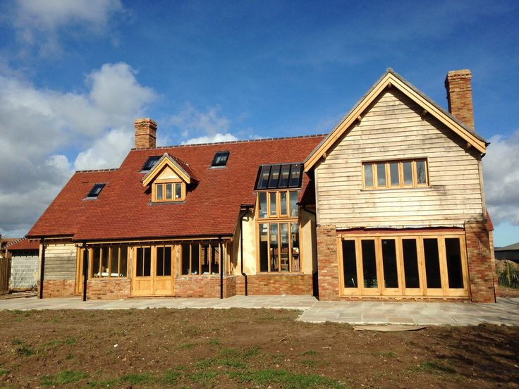 re:DSGN project, Bradford on Tone, Somerset. Bespoke oak joinery, feather edge oak cladding, brick base, lime render and plain clay tiles.
