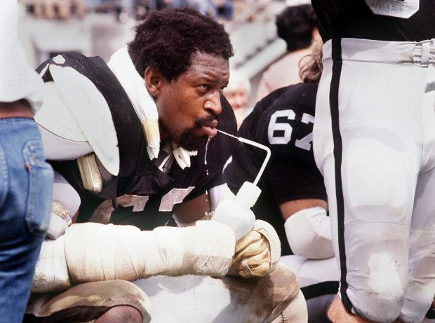Oakland Raider's Gene Upshaw takes a breather on the sidelines during a game aganist the Denver Broncos at the Oakland Coliseum in Oakland Calif. in 1978. (Dan Rosenstrauch/Bay Area News Group Archives))