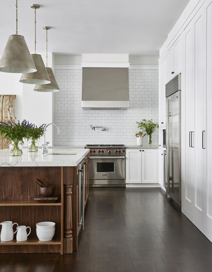 Wolf oven and stove top looking so good in this Flatiron Apartment by Chango & Co.