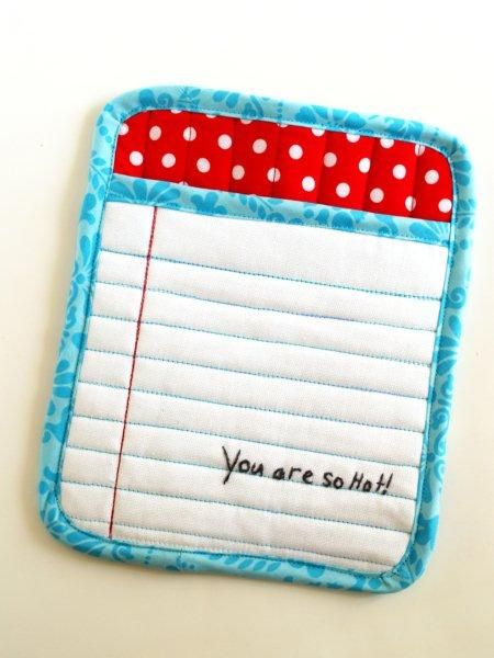 cute potholder - I like how the red and blue machine stitching make the white fabric look like old fashioned notebook paper.
