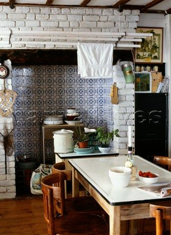 Victorian style blue and white tiles in the kitchen fireplace Vintage enamel and a swinging Sheila