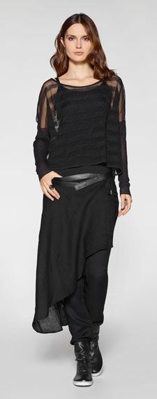 All black outfit by Belgian fashion designer Sarah Pacini. Leggins, long assymmetric skirt, dress and striped half transparent pullover