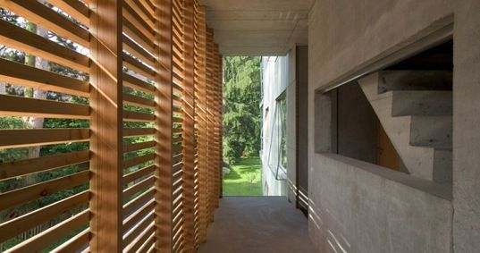 Timber slats lining wall. Picture it back-lit with a coloured wall.