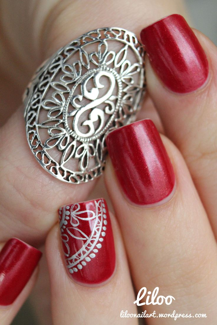 Red with silver accent nail art