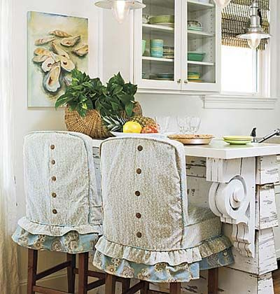 cute slipcovers. love the salvaged corbels on the bar.