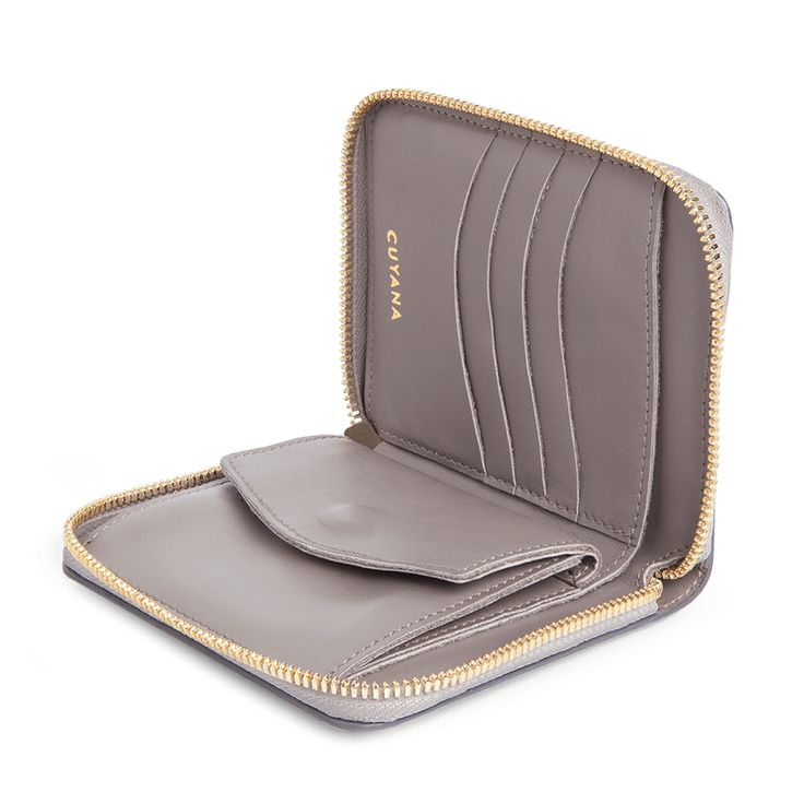 Beautifully compact, our small zip around wallet is designed with thoughtful simplicity and easy functionality. Externally, the ultra-smooth, full-grain leather and signature gold-tone zipper hardware slip easily into your grasp. Internally, several curved card slots and an ample coin pocket enable elegant organization. Our wallet is made in the USA with 100% Italian leather.