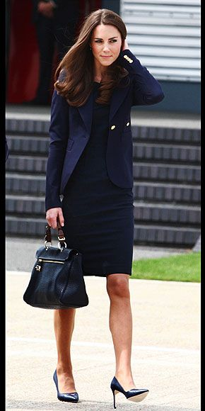 COME FLY WITH ME ~ In the outfit that started it all, Kate arrives at London's Heathrow Airport on June 30 to embark on her Canadian adventure with husband Prince William. The newlywed earns fashion (and diplomacy!) points for her navy ensemble: a tailored blazer by Canadian brand Smythe Les Vest over a Roland Mouret dress.