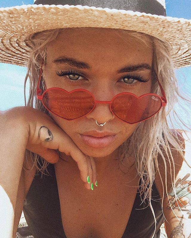 LOVER, LOVEROur beach babe @teganphillipa wears our new fave Quay Heartbreaker Sunglasses in Red &Lack Of Color The Spencer Boater♡ Shop her look online now, gals #PollyGalpollygal #PrincessPolly