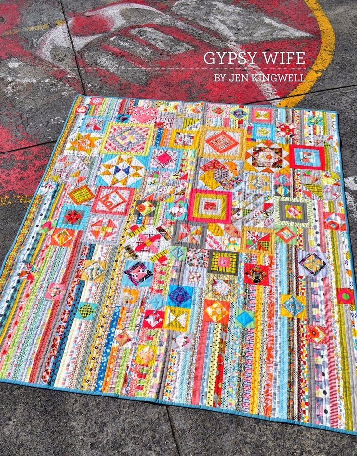 Added to the queue, Gypsy Wife. Like the string piecing paired with the blocks in this. And the colors.