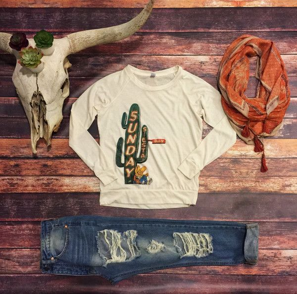 Cactus...Neon Lights...Sleeping Amigo...This Sunday Siesta Tee has it all. A long sleeve, off White oatmeal color with cuffed arms and fitted waist band. Poly