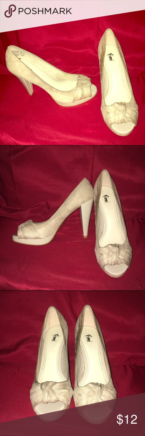 Beige Peep Toe Pumps Nice pump style shoe with peep toe. Suede material. Size 7. Signs of wear, not noticeable when wearing. FIONI Clothing Shoes Heels