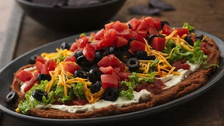 Dig in to a delicious homemade dip. Make it by layering your favorite Mexican ingredients.