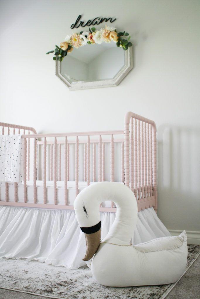 Sweet pink crib in this stunning nursery featuring Land of Nod Swan Plush