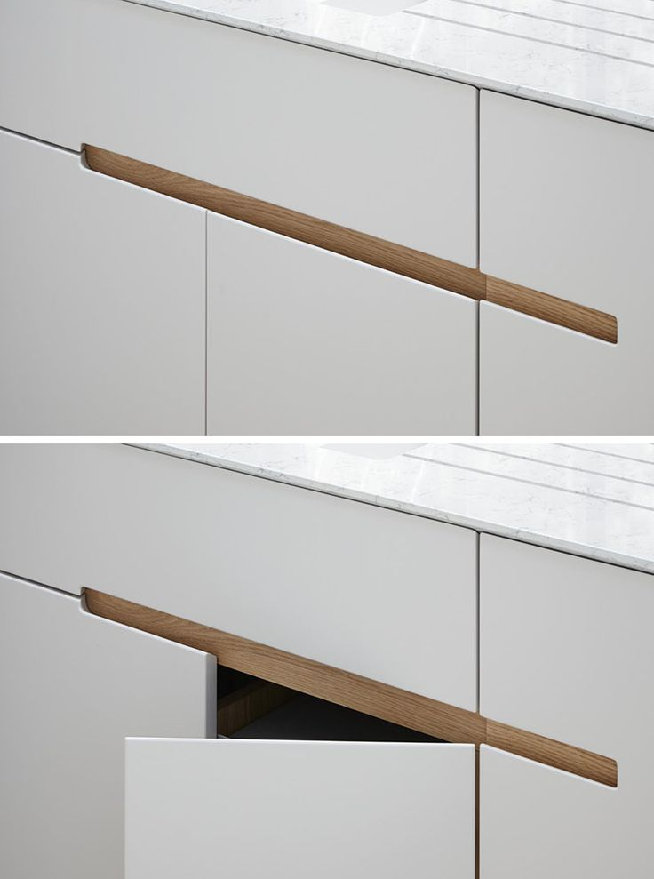 No Hardware For The Kitchen Cabinets In This London Home // This kitchen has white melamine cabinets with a recessed finger detail made from European oak, to make it easy to open the drawers and cabinets.